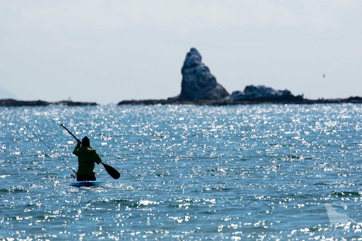 烏帽子岩と釣り人